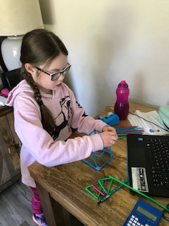 Holly building 3D shapes with straws