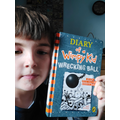 Dylan enjoying Diary of a Wimpy Kid
