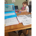 Kailee working hard at home at the start of Week 3
