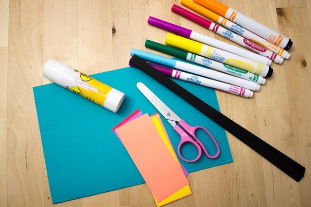 1. Gather glue, your craft paper and felt tips