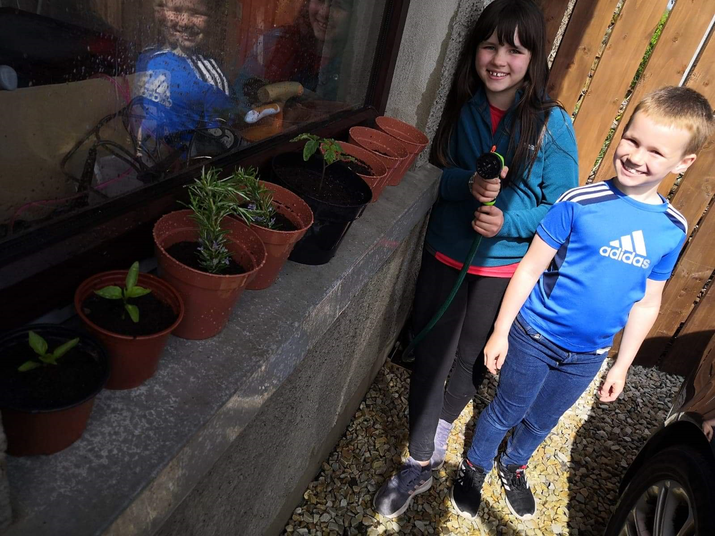 Mia-Rose and Dylan planting in the sun