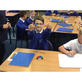 We divided a number into fractions using cubes.