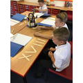 We created Roman numerals using lollipop sticks.