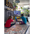 Mia and Michael doing their Joe Wicks PE lesson