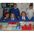 Having fun building big numbers in maths.