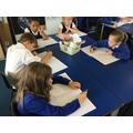 Writing descriptive sentences about Stone Age Boy