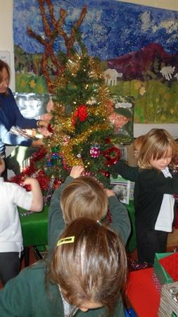 The children decorated the Christmas Tree.