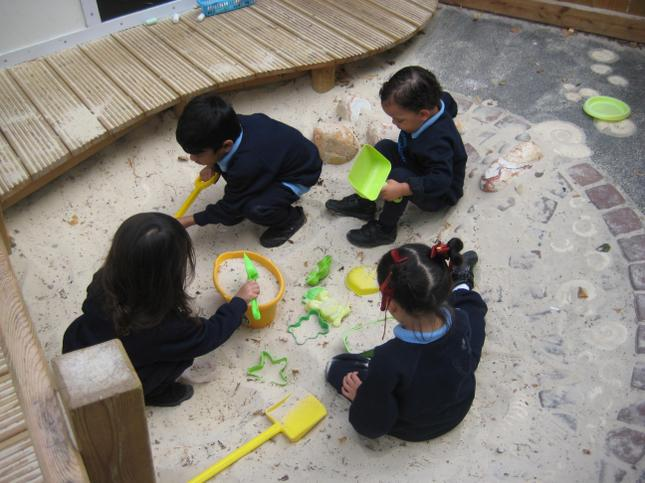 We are busy in the sandpit using the moulds.