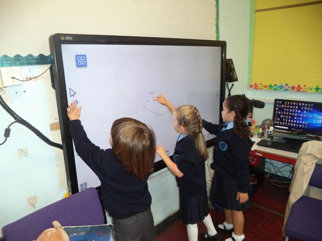 Practising writing our names on the Ctouch board.