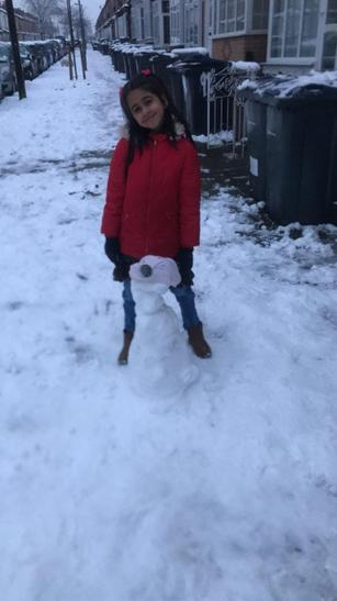 Maleeha and her snowman!