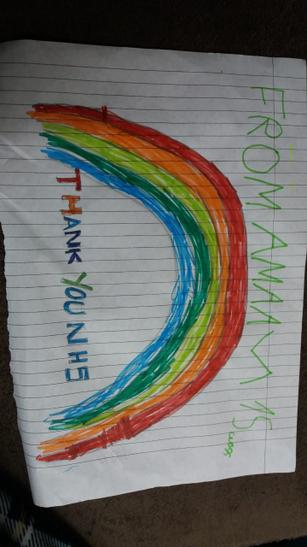 Amaan has drawn a lovely rainbow at home.