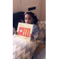 Naairah reading Dear Zoo.