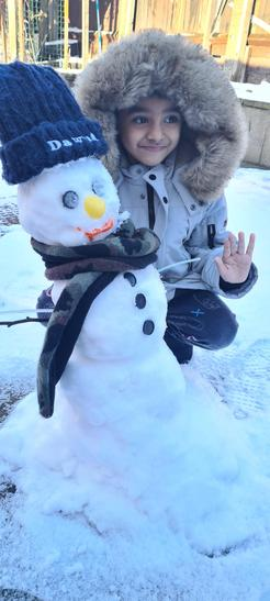 Dawud borrowed his hat to his snowman!