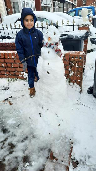 Hamza and his snowman!