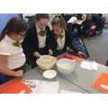 Sieving raisins from flour