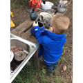 The children love to explore the mud kitchen!