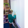 We enjoy drawing pictures on the whiteboard.