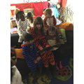 In our pyjamas reading stories about monsters