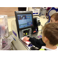 Year 5 shopping in Tesco for their ingredients wit