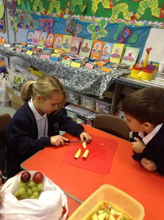 Learning to safely use sharp knives to cut fruit!