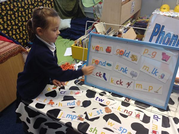 Working hard at our Phonics table!