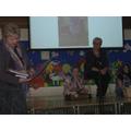 Mrs Brennan reading an IEP we made for Mrs Whisker