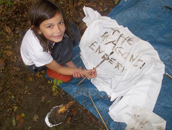 Millie making a flag for her den