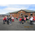 Year 3 learning French dances with Yannick the playground