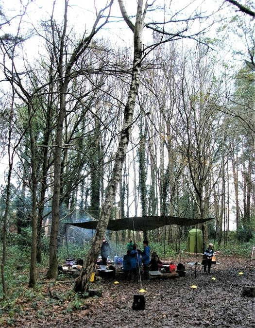 Camp HQ surrounded by bare winter trees