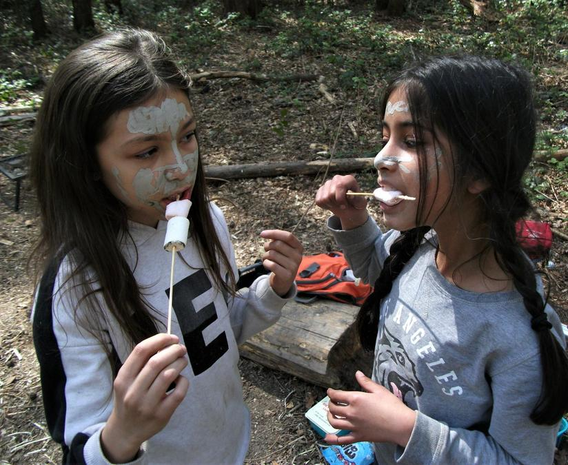 Munching veggie marshmallows with painted faces