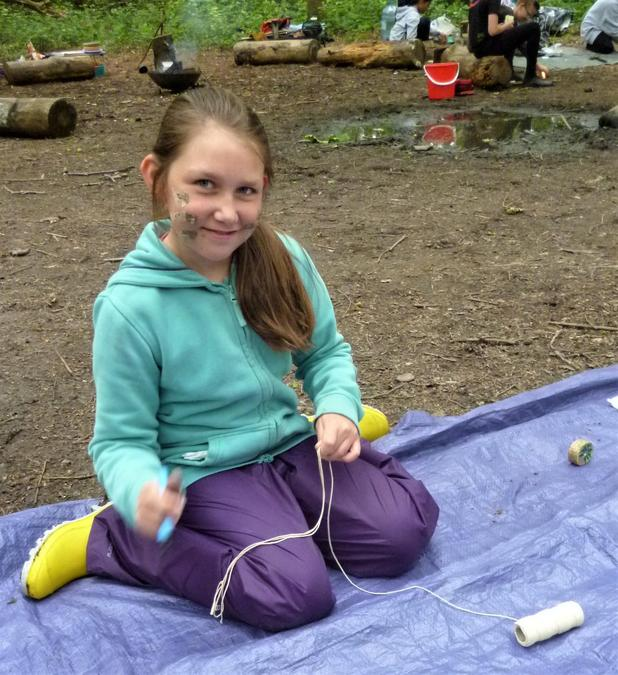 Making amulets in the summertime wood