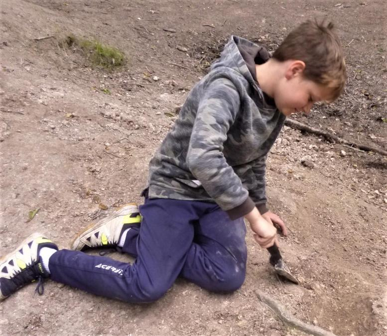 Relaxed and smiling while digging