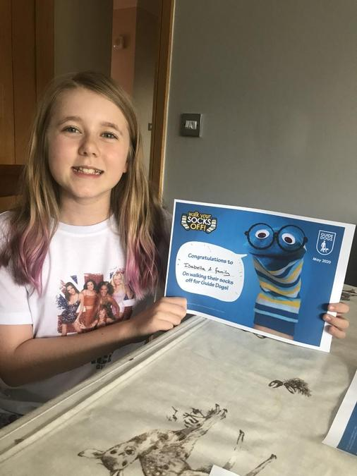 Izzy raised £240 for guide dogs in half term!