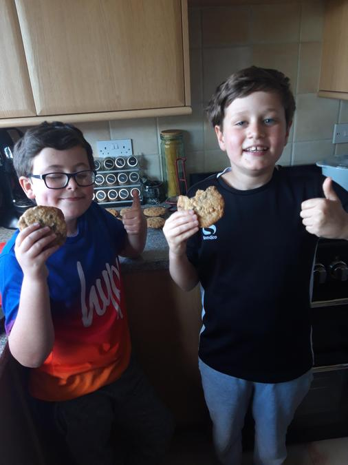 Oliver & Nathan enjoying their scrumptious cookies