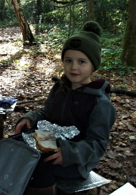 A relaxing lunch in the woods by the fire