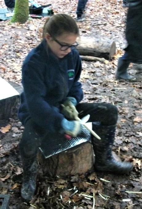Learning to strip bark around the warm campfire