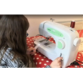 Mary-Jane learning to use a sewing machine.