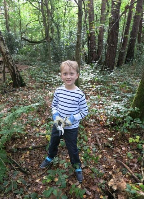 Snipping brambles to make survival rope