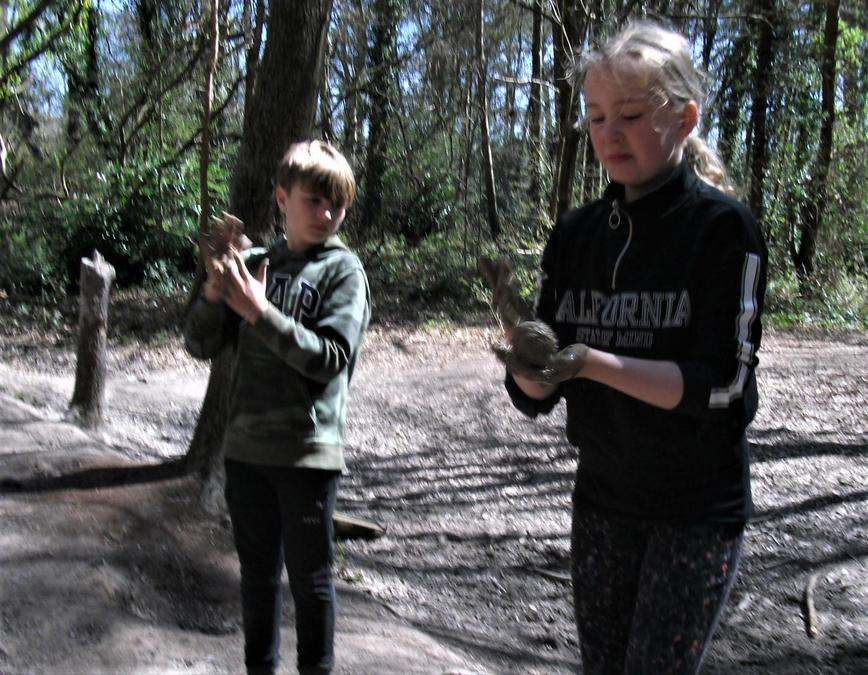 Making mud balls! And why not?