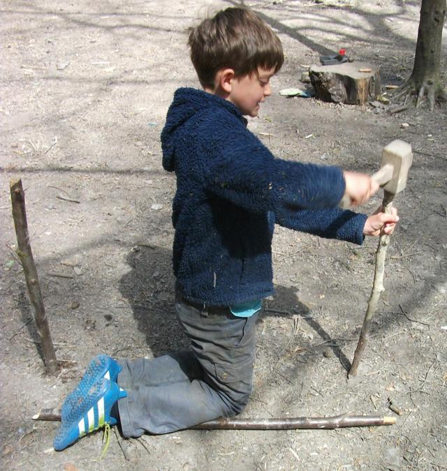 Bashing sticks in the middle of a path ... but why?