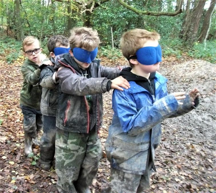 Blindfold games in the woods ... and mud!