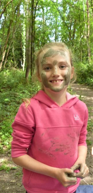 Getting creative with the natural clay face painting