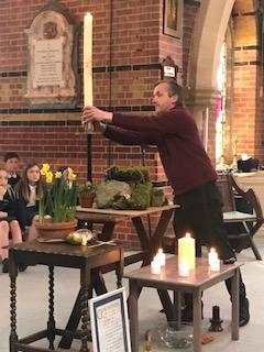 Father Wim leading the Easter Service 2021