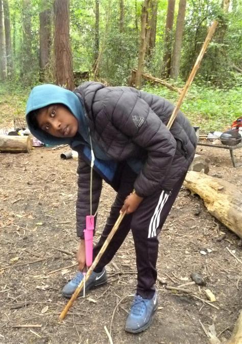 Whittling a long spear!