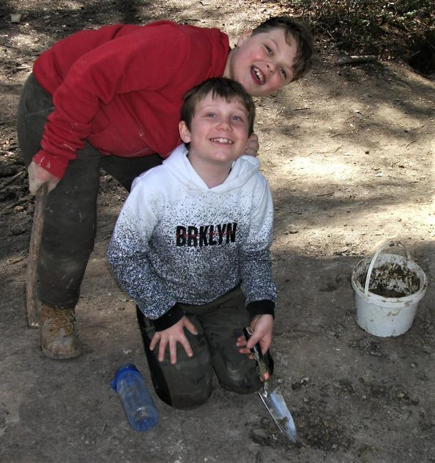 Big smiles while digging for clay