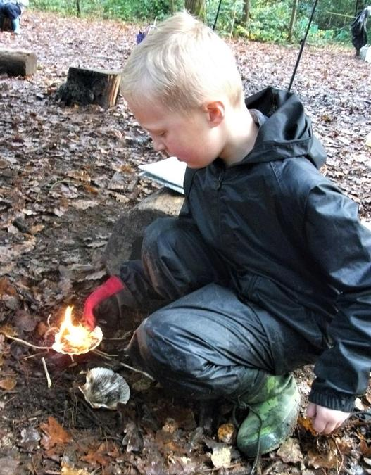 Carefully moving our mini fire to the get the big one going