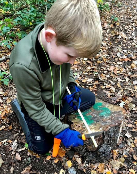 Learning safe knife skills to shape wood