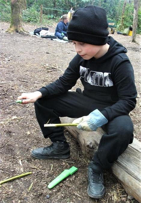 Whittling around the camp fire