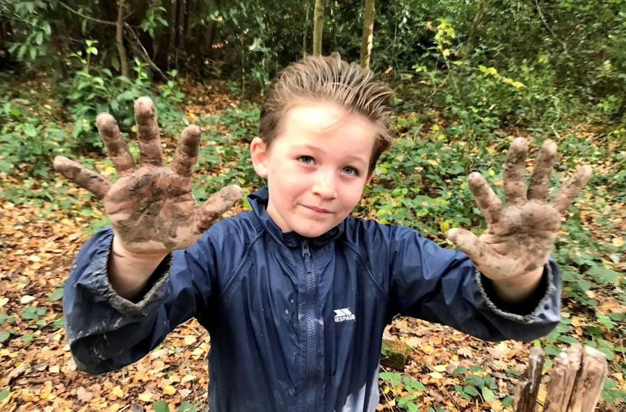 Mucky paws making tree faces with mud and clay