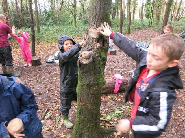 Making tree faces from freshly dug clay